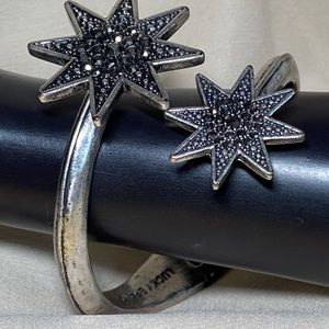 Lucky silver tone spring bracelet with rhi…